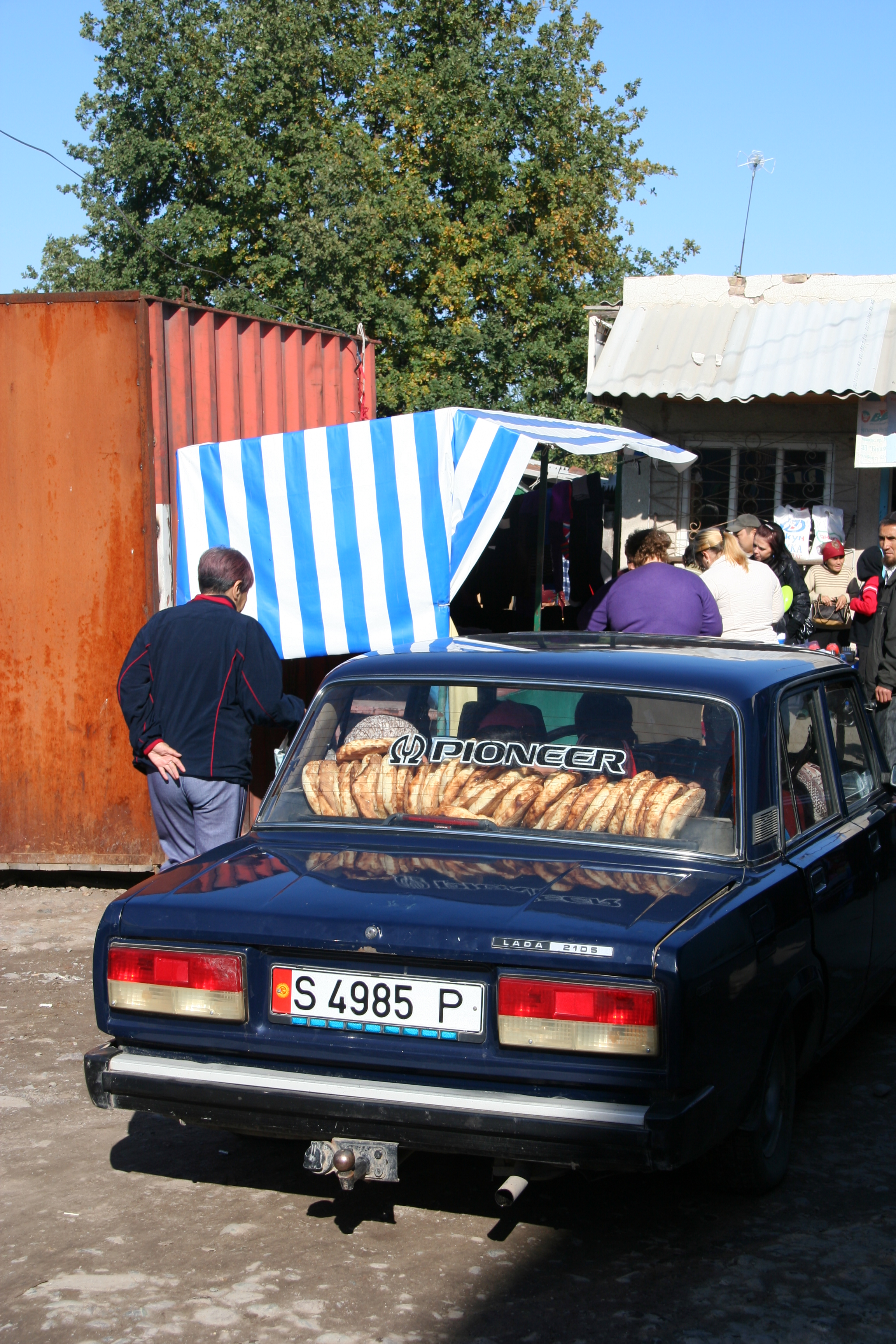 Lepyoshki (Kyrgyz loafs of bread) in a Lada